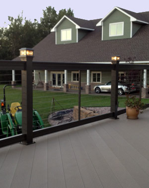 Traditional cable railings with aluminum decking.